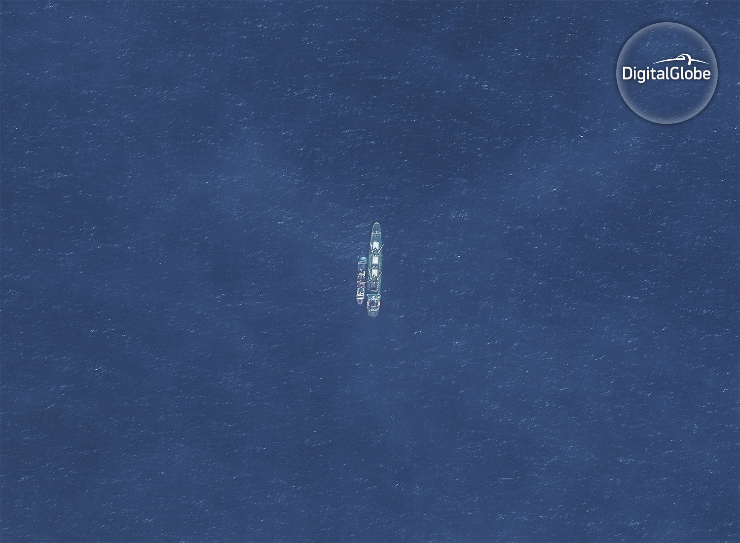 Credit line: Imagery by DigitalGlobe © 2017 -The Hai Feng 648 is with an unidentified fishing vessel off the coast of Argentina. There is a large mostly Chinese squid fleet just beyond the EEZ boundary. The Hai Feng 648 was previously with the squid fleet at the edge of the Peruvian EEZ and in 2014 took illegally processed catch from the Lafayette into port in Peru. This image was acquired on Nov 30, 2016.