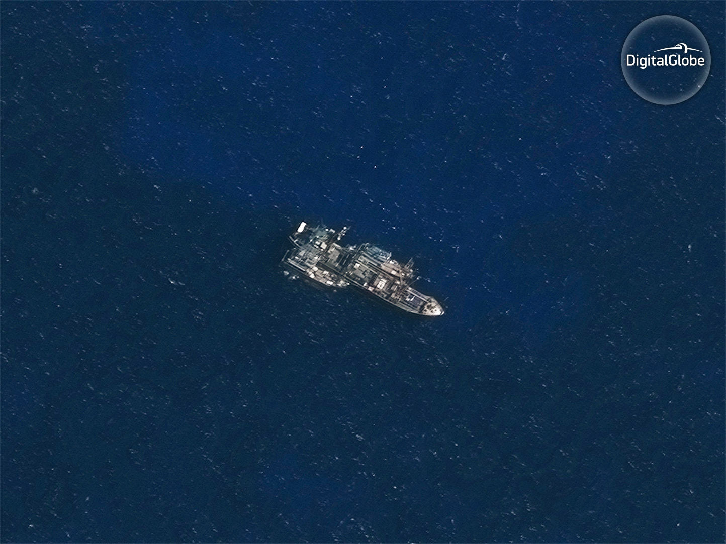 The refrigerated cargo vessel (reefer) Leelawadee with two unidentified likely fishing vessels tied alongside. Captured by DigitalGlobe on November 30, 2016. (DigitalGlobe)