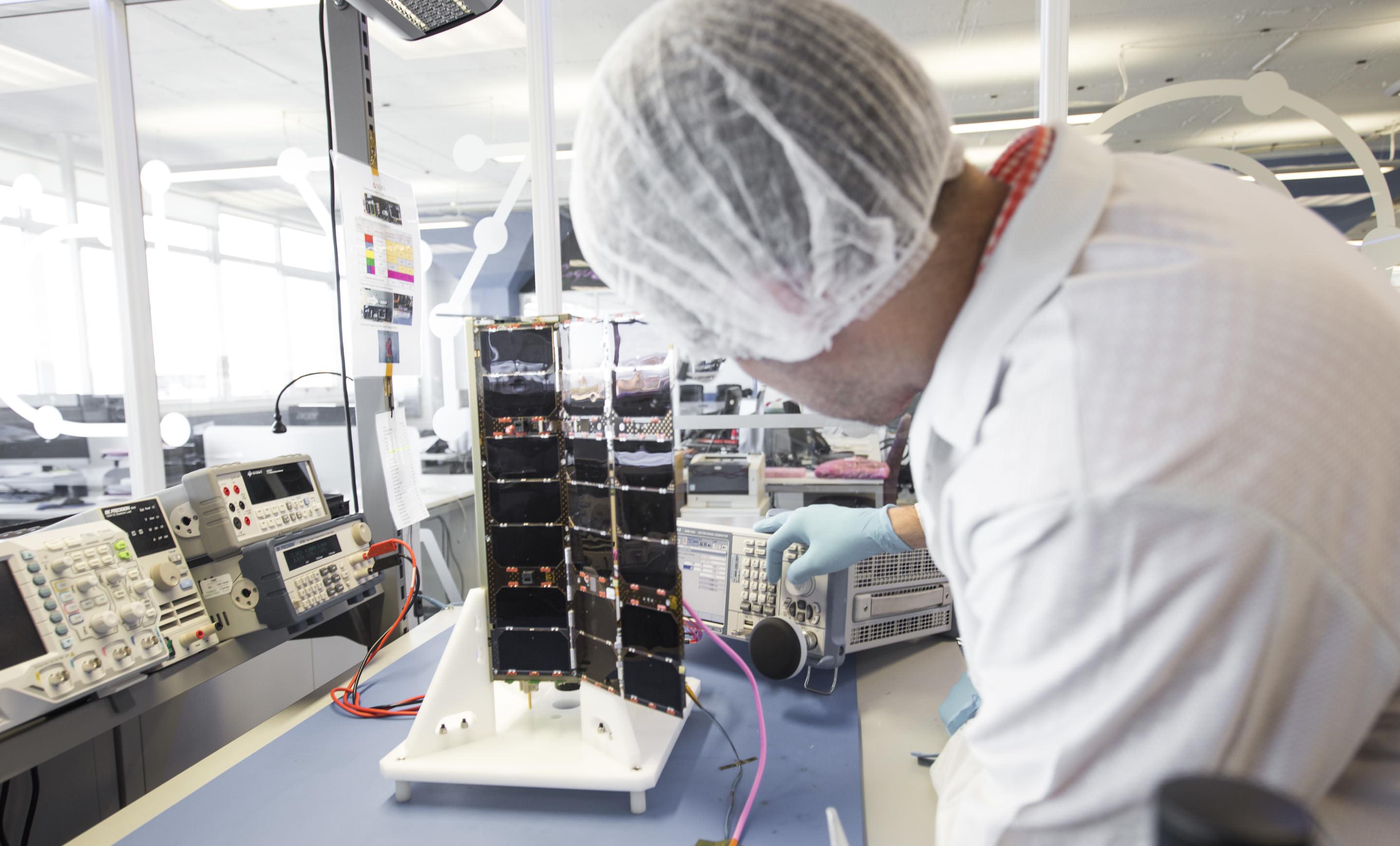 Spire nano satellite undergoing testing