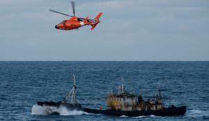 United States Coast Guard patrols over illegal driftnet fishing vessel