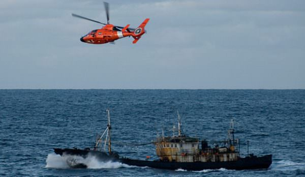United States Coast Guard patrols over illegal driftnet fishing vessel