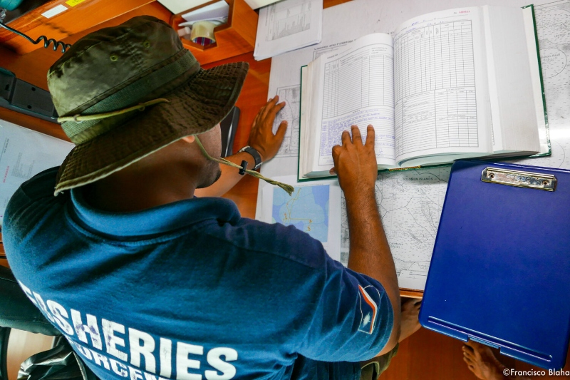 Officer crosschecks suspicious vessel behaviors identified in VMS data in the Marshall Islands