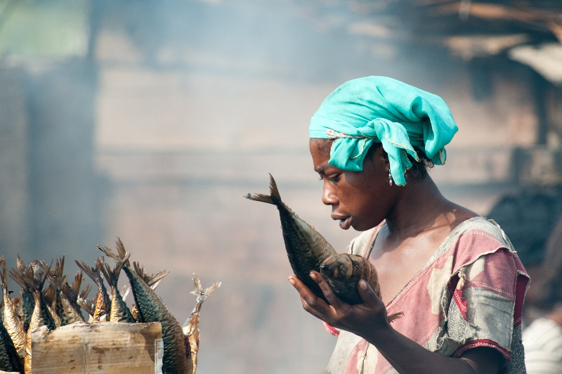 Ghanaian woman works on a fish market in Ghana